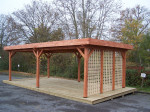 Auvent OMBRA toit plat couverture bac acier +  treillage en bois sur 1 côté / 3,54 m x 6,96 m